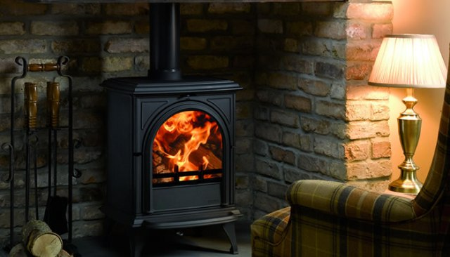 Black woodburning stove in a living room.